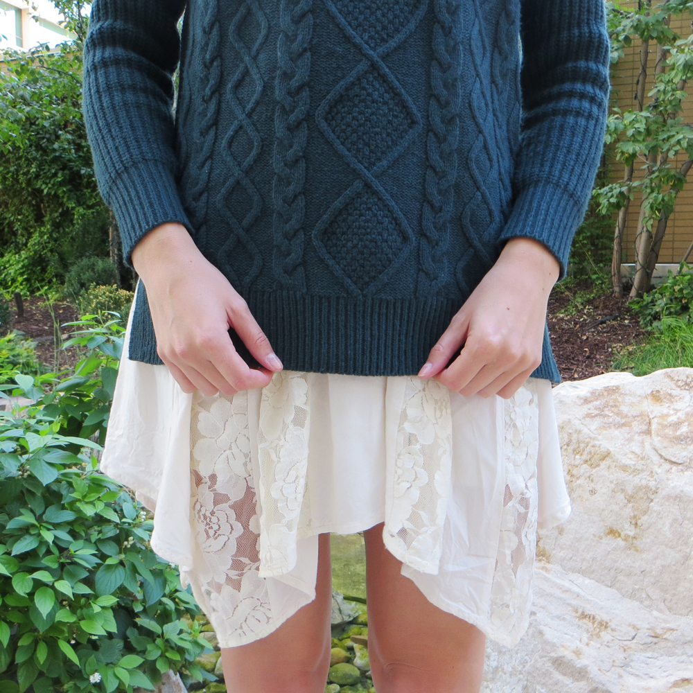 Forest green cable knit sweater + asymmetrical lace dress -- Cotton Cashmere Cat Hair