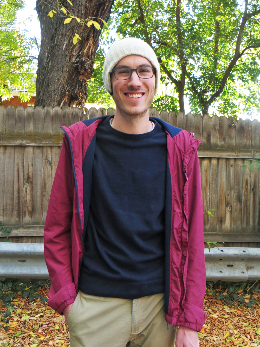 His grad student style: Burgundy light jacket, navy sweater, khaki pants, beanie -- Cotton Cashmere Cat Hair