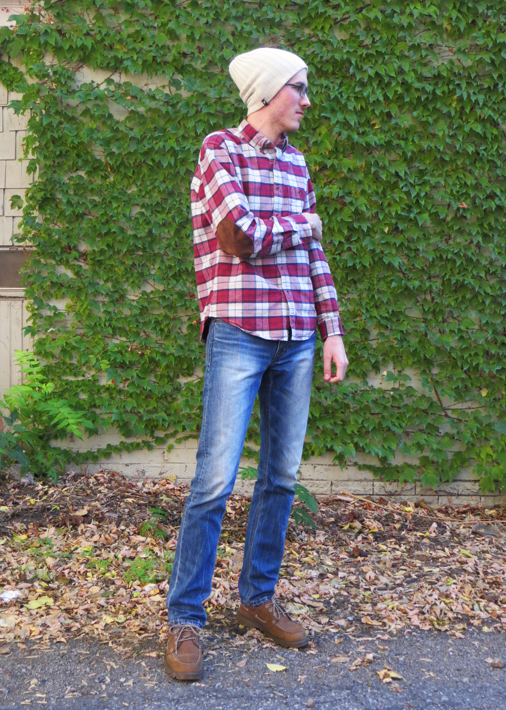 His grad student style: Plaid workshirt, skinny jeans, brown boat shoes, beanie -- Cotton Cashmere Cat Hair