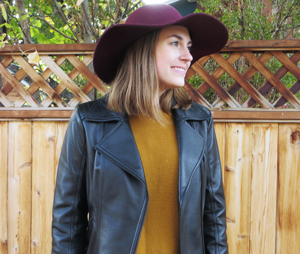 Black leather jacket, gold sweater, burgundy felt hat -- Cotton Cashmere Cat Hair