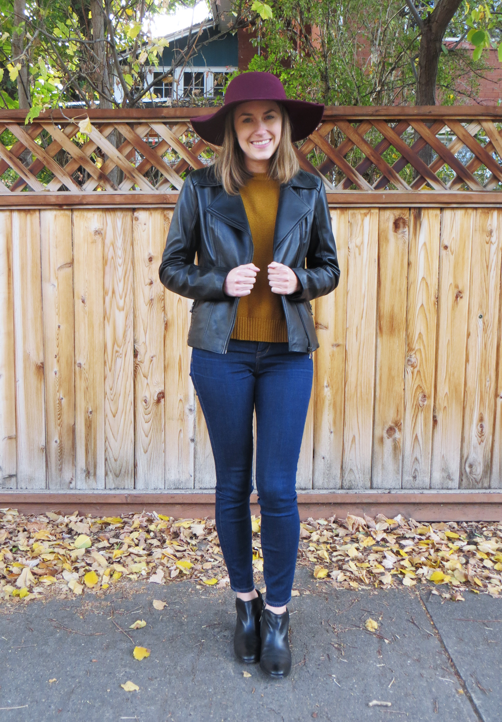 Black leather jacket, gold sweater, skinny jeans, ankle boots, burgundy felt hat -- Cotton Cashmere Cat Hair