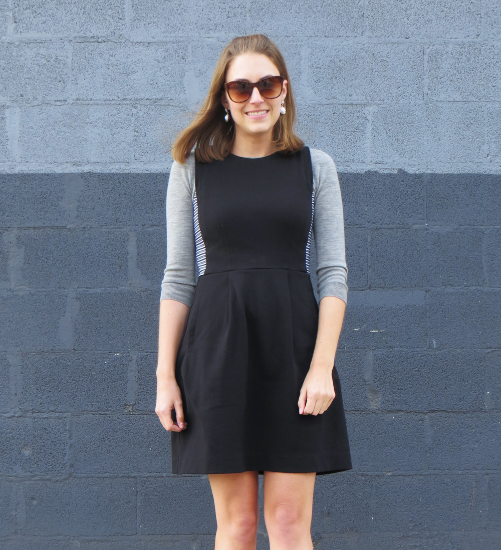 Light grey sweater, black dress, statement earrings -- Cotton Cashmere Cat Hair