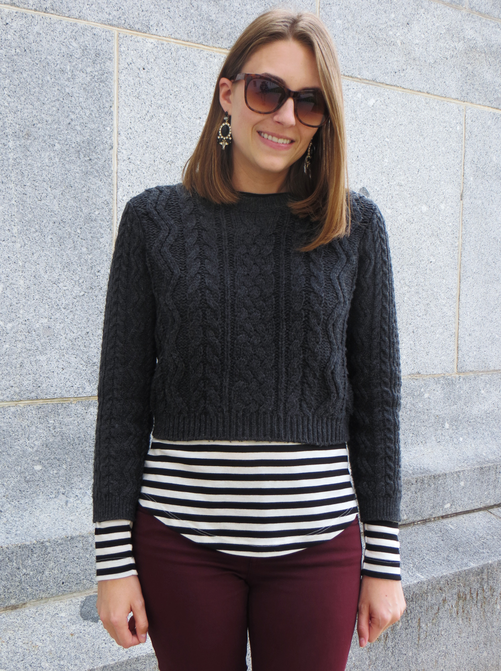 Cropped cable knit sweater, striped tee, statement earrings -- Cotton Cashmere Cat Hair