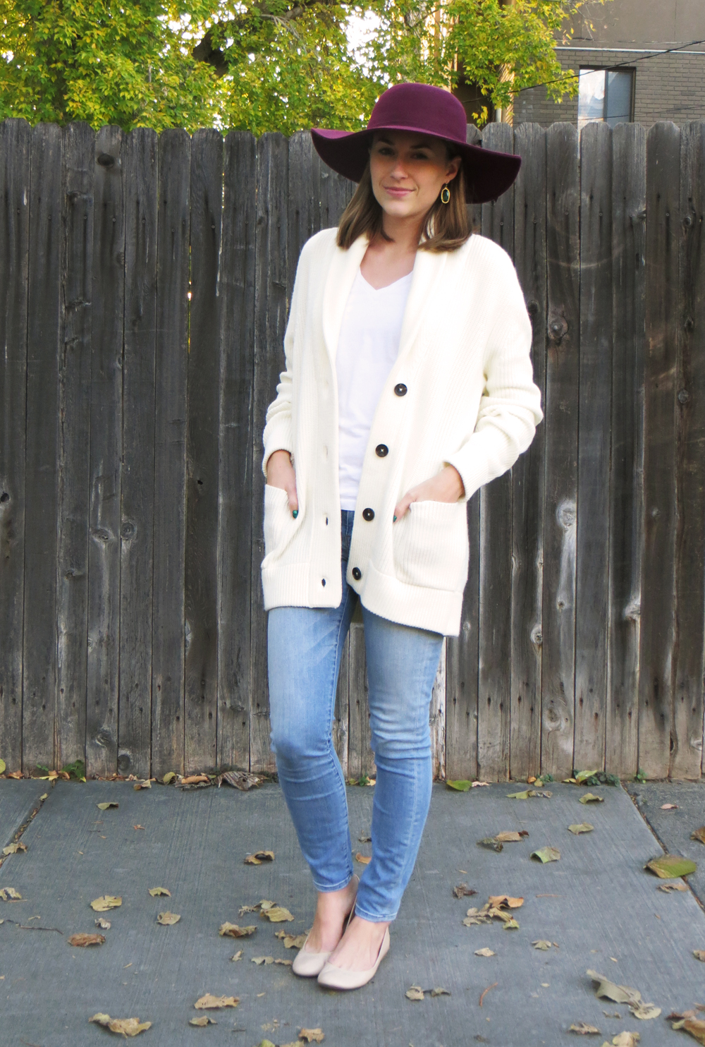 Ivory knit cardigan, white tee, light wash denim, burgundy hat, emerald green earrings -- Cotton Cashmere Cat Hair