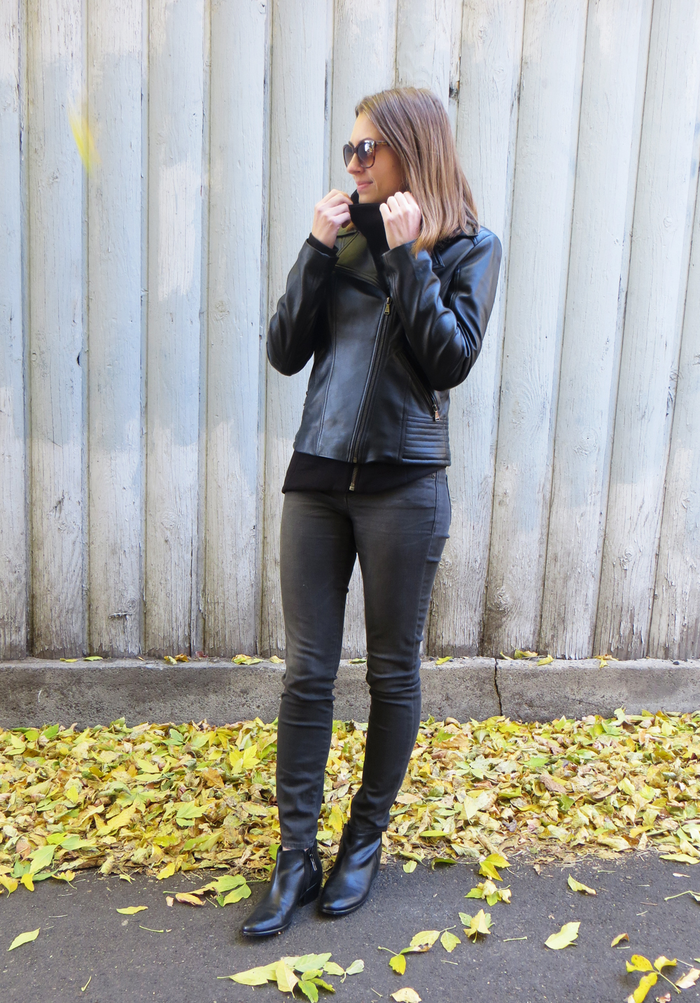 Black leather jacket, asymmetrical sweatshirt, grey skinny jeans, black ankle boots — Cotton Cashmere Cat Hair