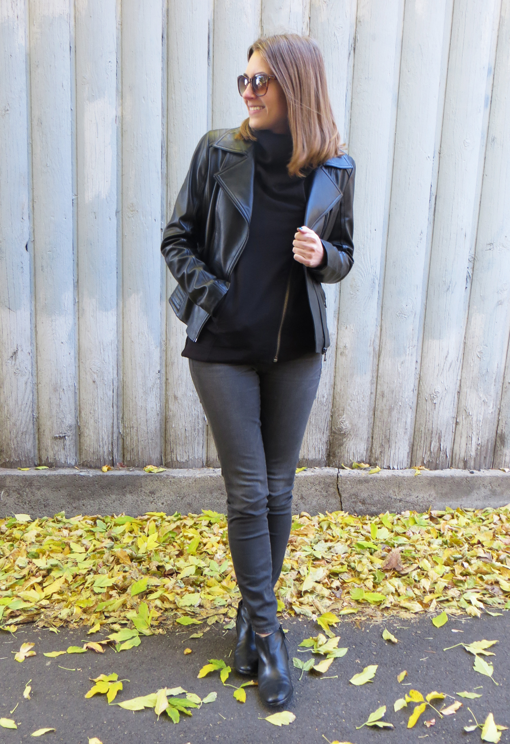 Black leather jacket, asymmetrical Helmut Lang sweatshirt, grey jeans, ankle boots — Cotton Cashmere Cat Hair