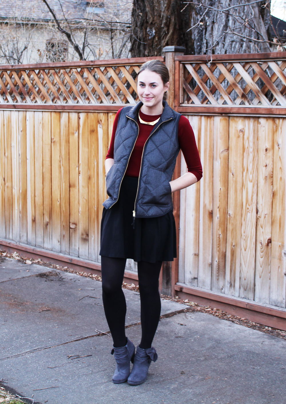 Grey puffer vest, burgundy sweater, black skirt, grey booties — Cotton Cashmere Cat Hair