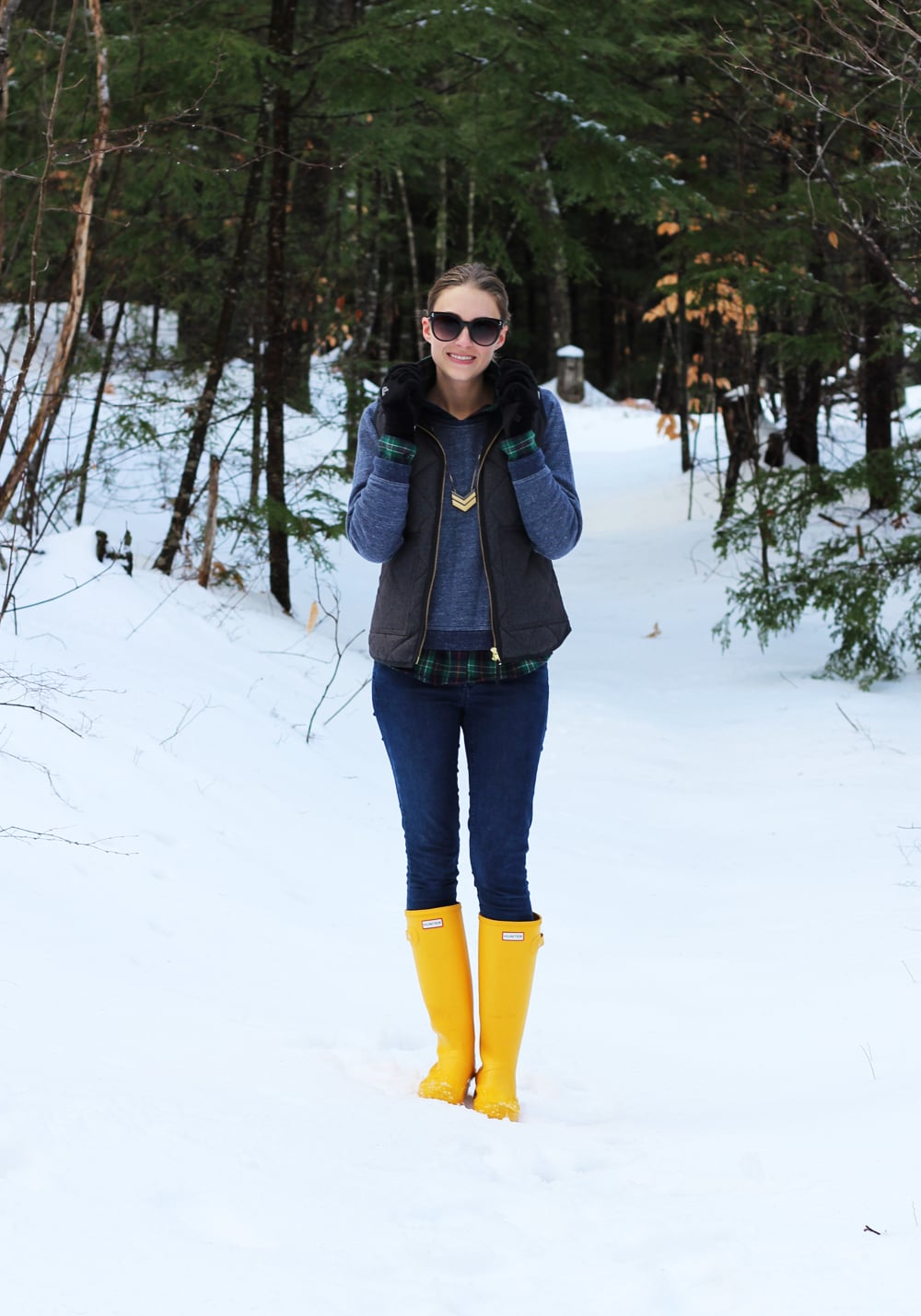 Grey puffer vest, navy sweatshirt, flannel shirt, skinny jeans, Hunter boots — Cotton Cashmere Cat Hair