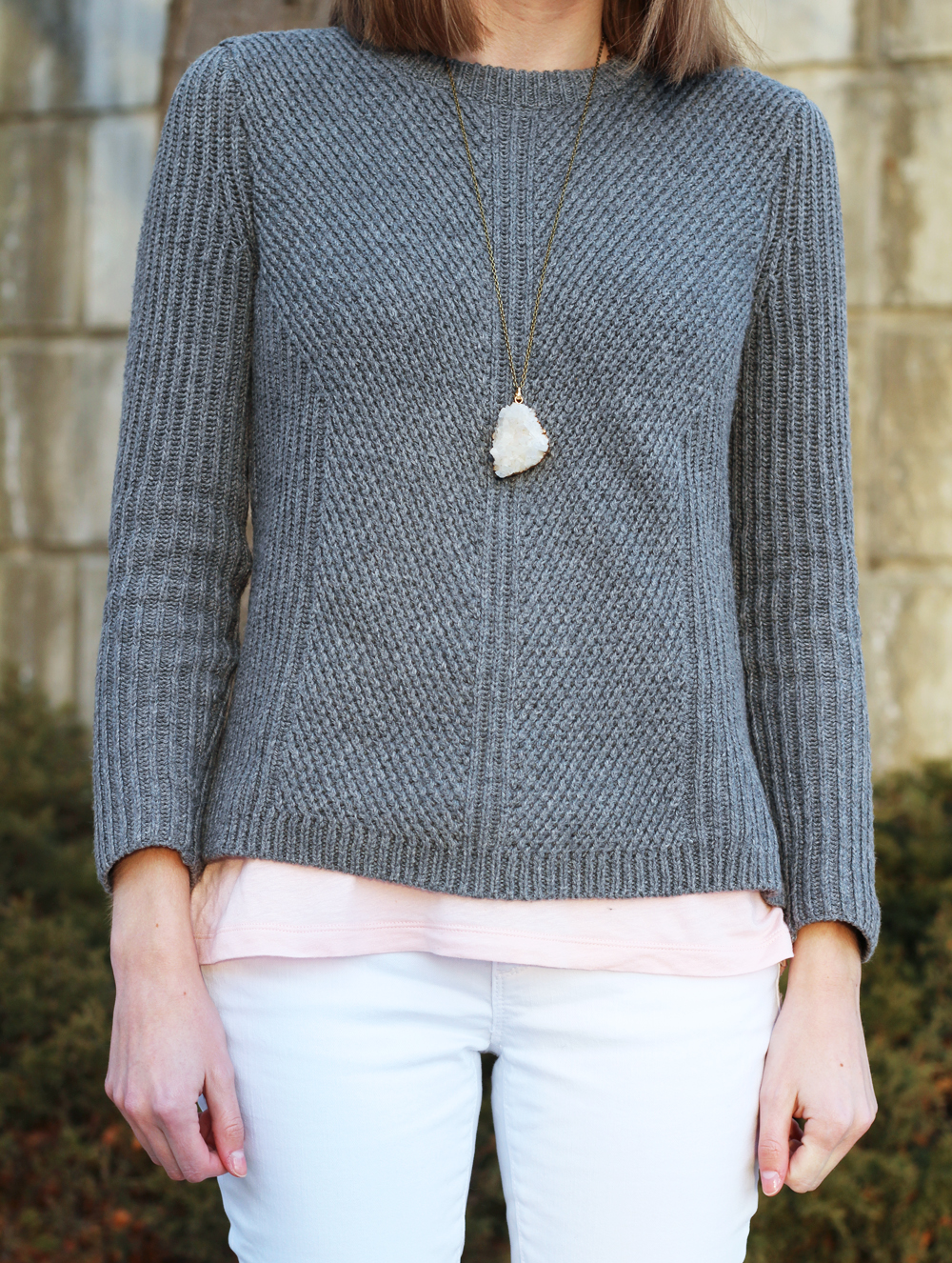 Grey sweater layered over pink tank top + white denim + quartz pendant — Cotton Cashmere Cat Hair