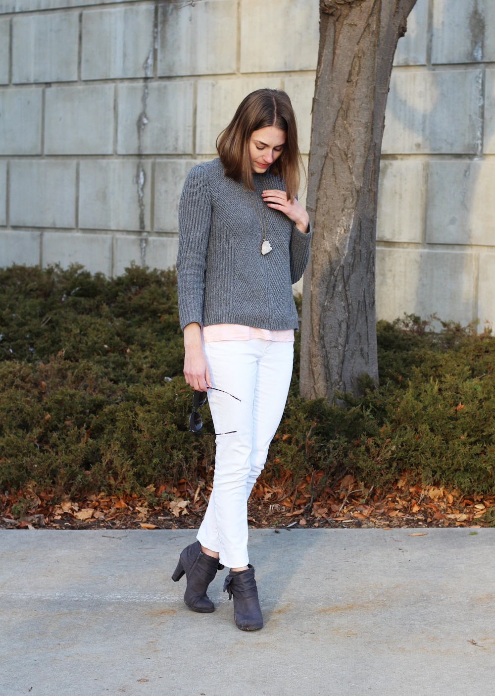 Grey sweater layered over pink tank top, white denim, grey ankle boots, quartz pendant — Cotton Cashmere Cat Hair