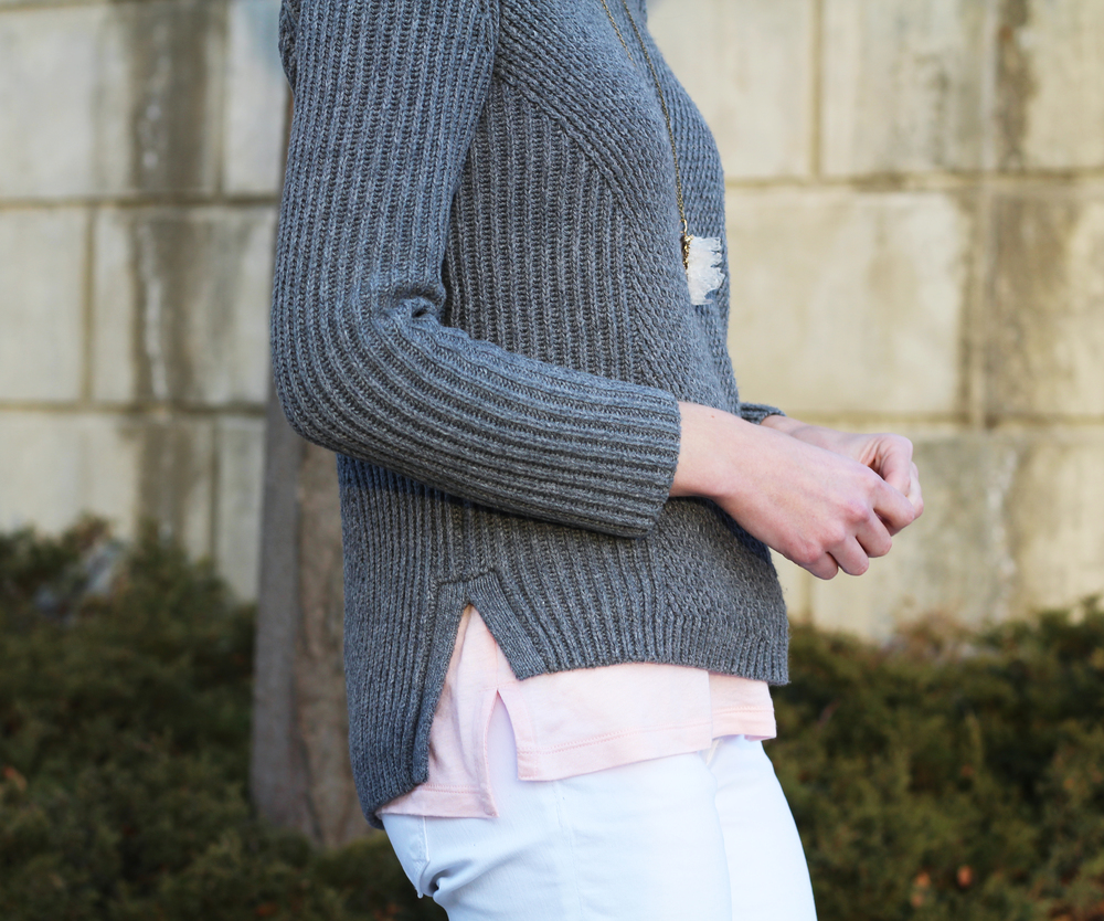 Grey sweater layered over pink tank top, white denim, quartz pendant — Cotton Cashmere Cat Hair