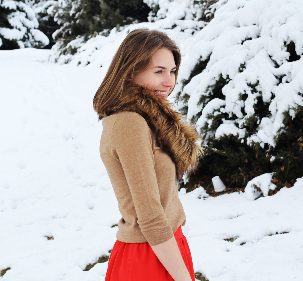 Faux fur scarf + camel sweater + red skirt — Cotton Cashmere Cat Hair