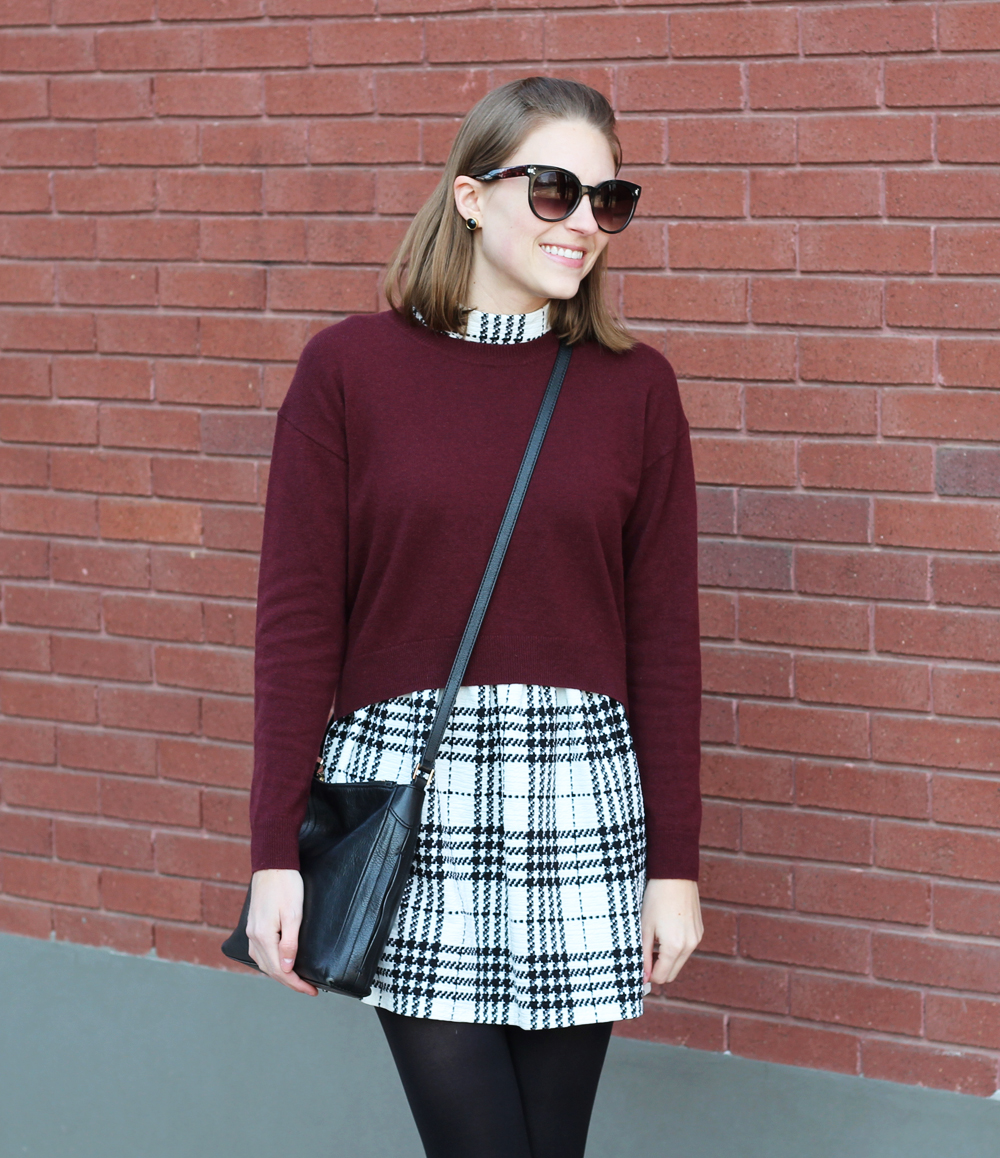 Burgundy cropped sweater over plaid dress + black crossbody bag — Cotton Cashmere Cat Hair