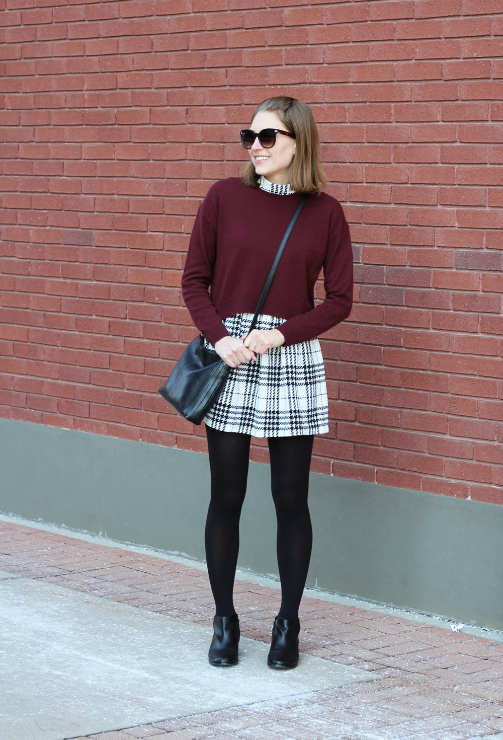 Burgundy cropped sweater, plaid dress, black ankle boots, black crossbody bag — Cotton Cashmere Cat Hair