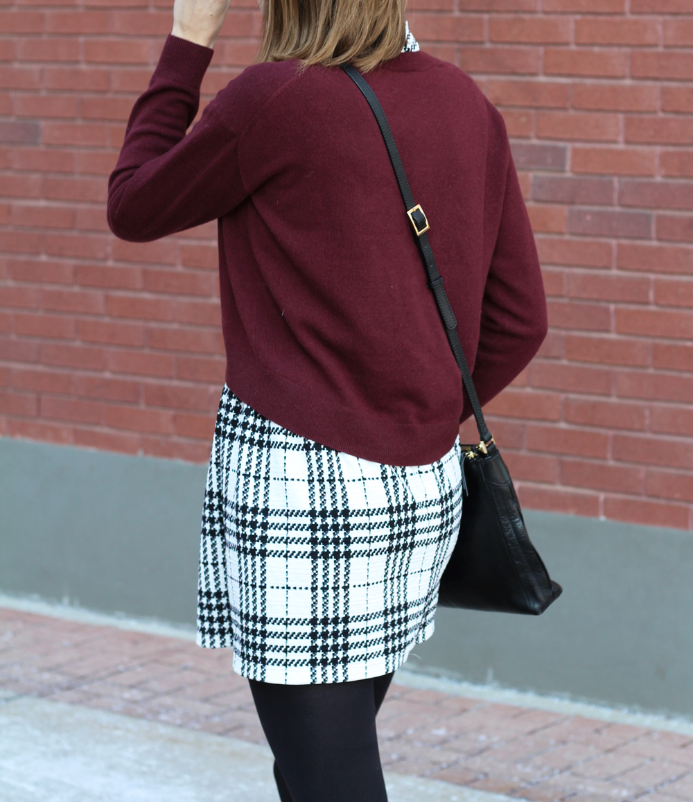 Burgundy cropped sweater + plaid dress + black crossbody bag — Cotton Cashmere Cat Hair