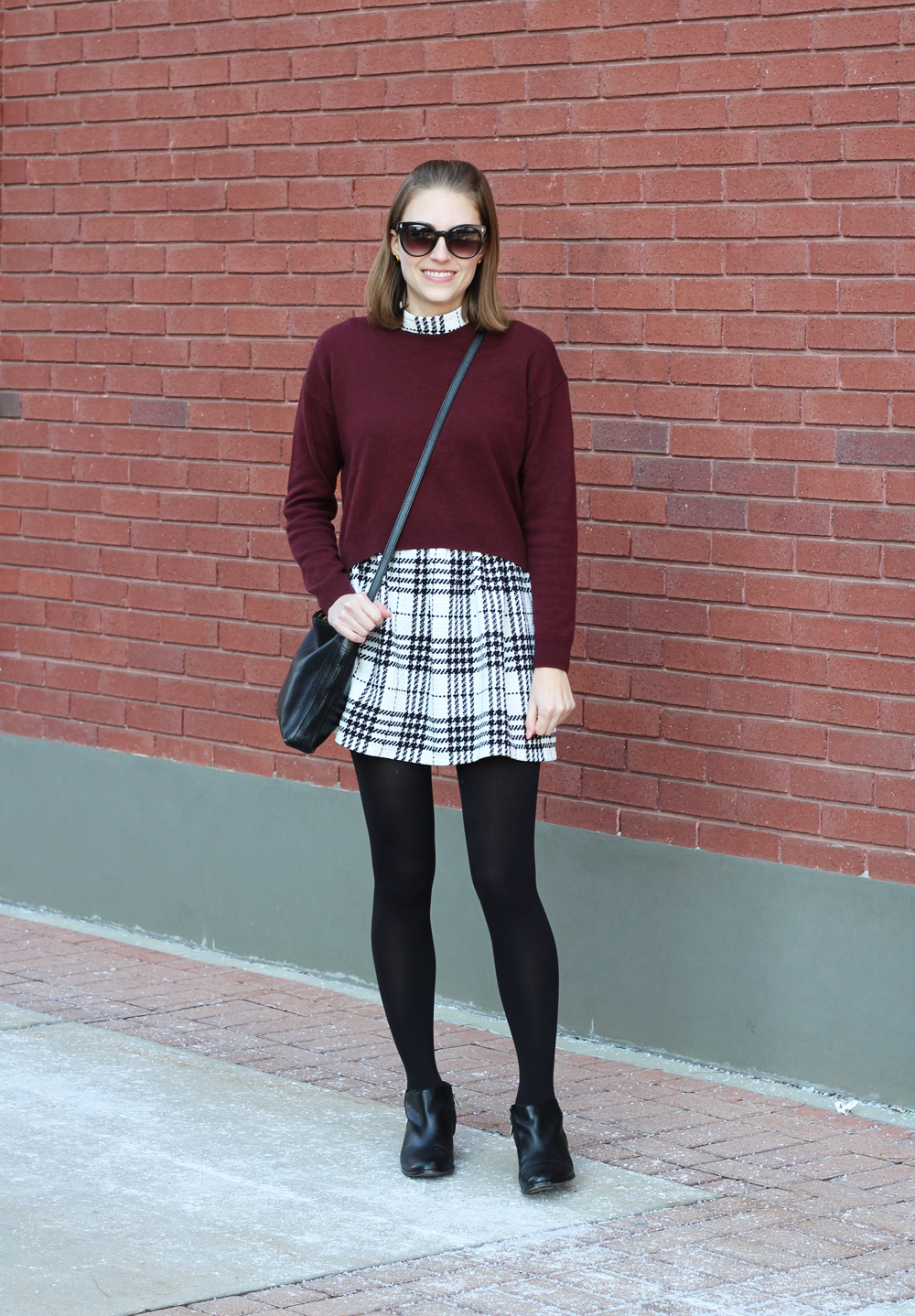 Burgundy cropped sweater, plaid dress, black ankle boots, black crossbody bag — Cotton Cashmere Cat Hair
