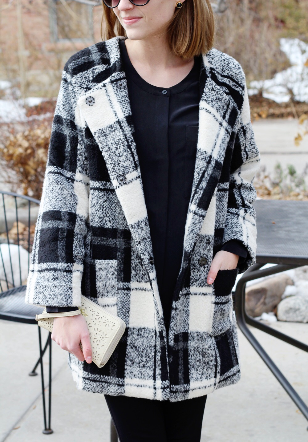 Plaid coat + black silk top + perforated leather wristlet — Cotton Cashmere Cat Hair