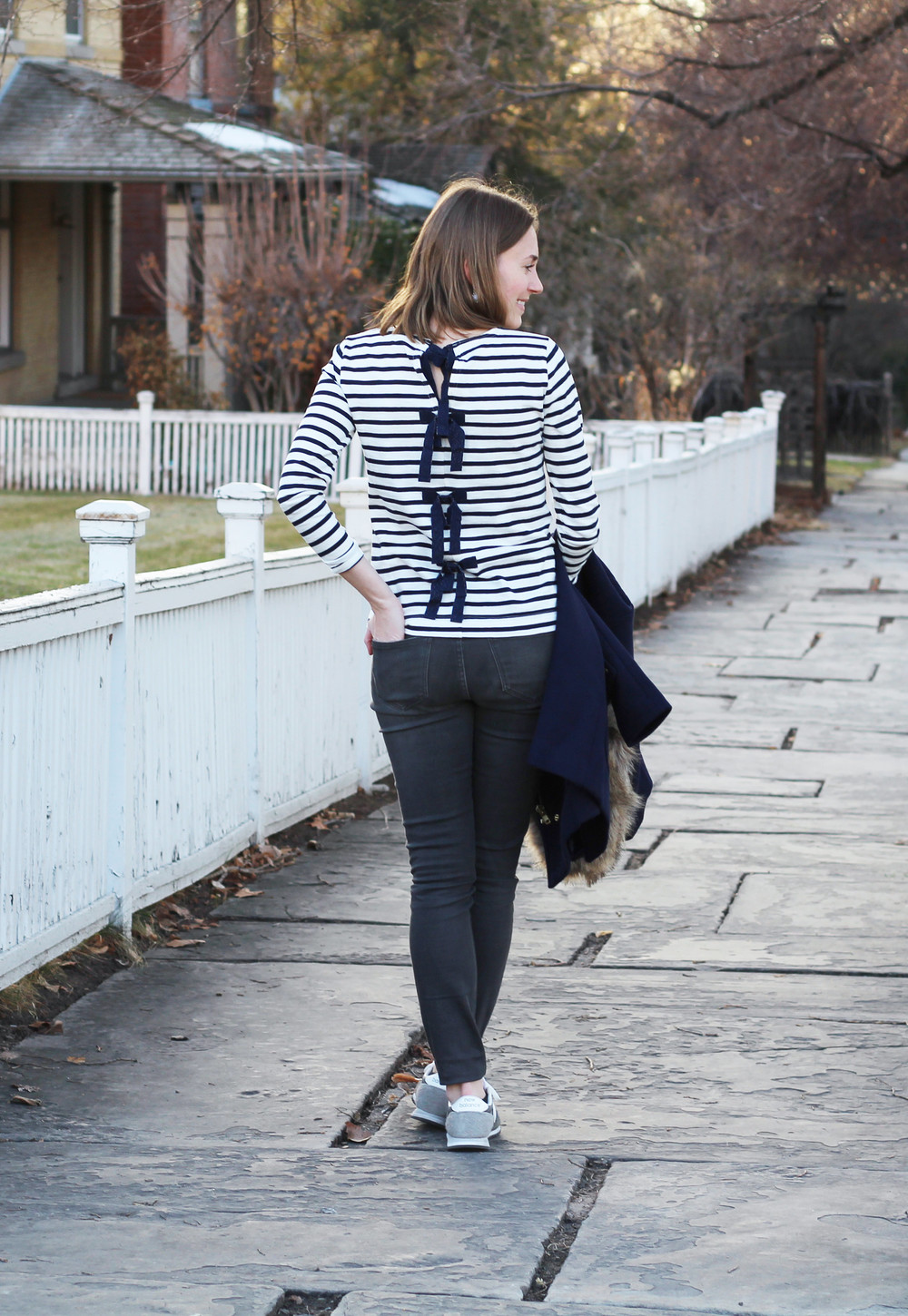 Bow-embellished striped tee + grey skinny jeans + New Balance sneakers -- Cotton Cashmere Cat Hair