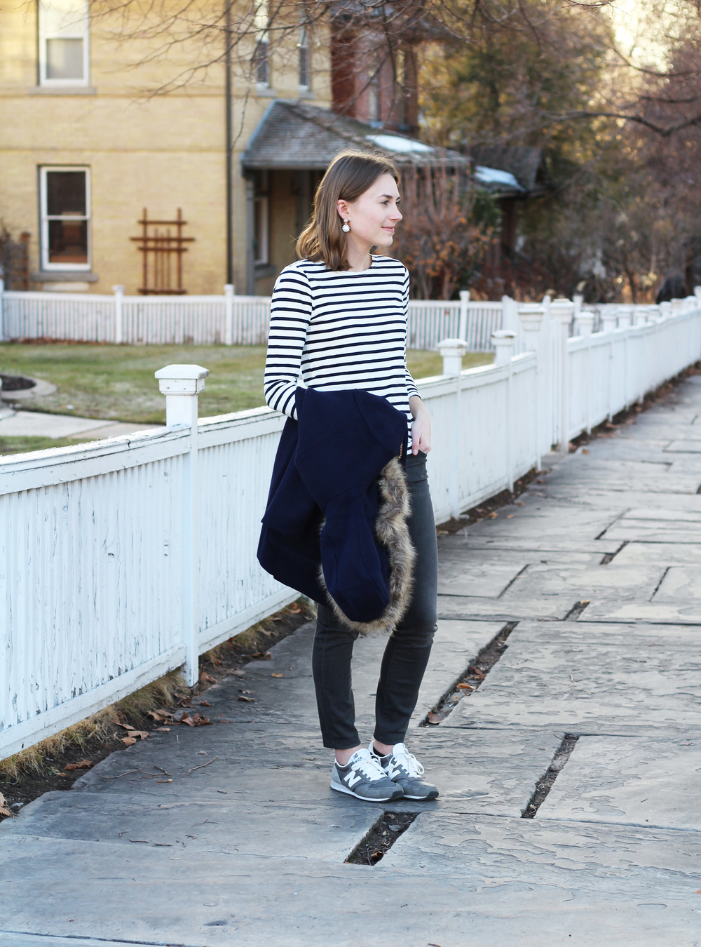 Navy striped tee, grey skinny jeans, grey New Balance sneakers -- Cotton Cashmere Cat Hair