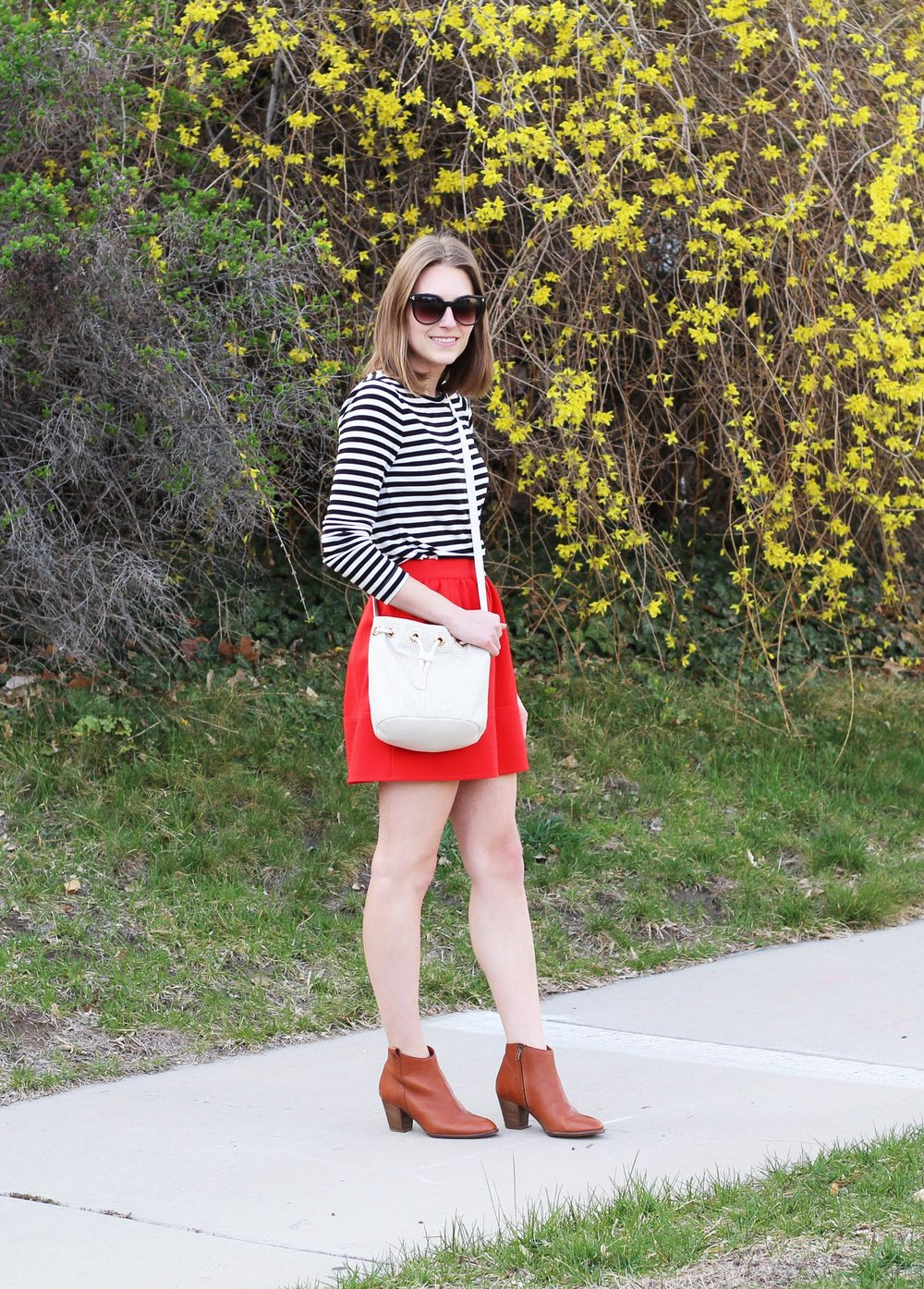 Black and white striped tee, red mini skirt, cognac ankle boots, white leather bucket bag — Cotton Cashmere Cat Hair