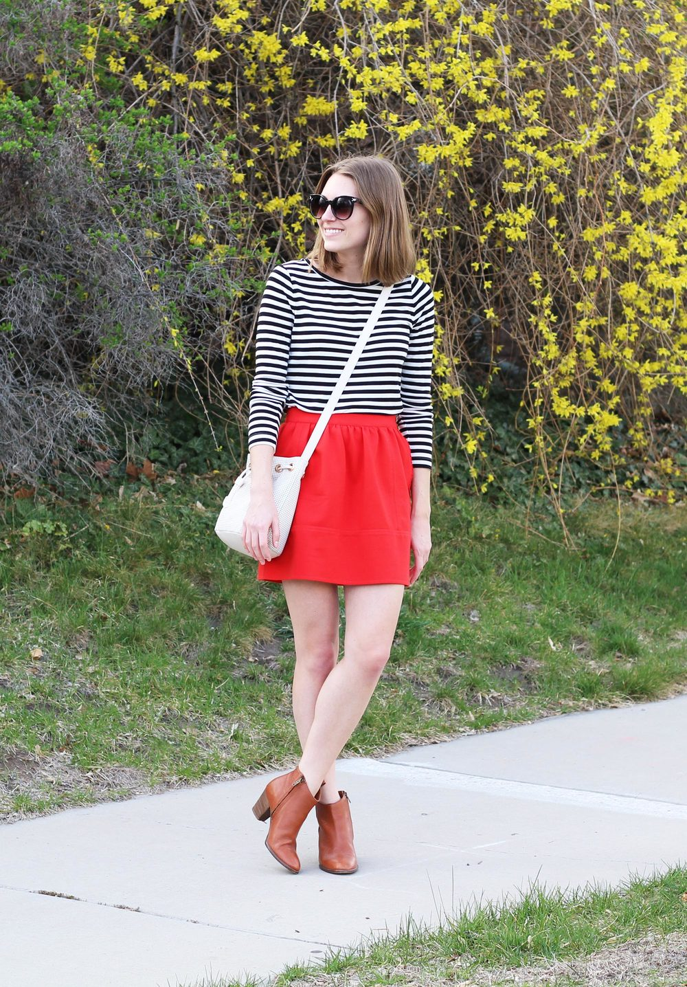 Black and white stripes, red skirt, cognac ankle boots, white bucket bag — Cotton Cashmere Cat Hair