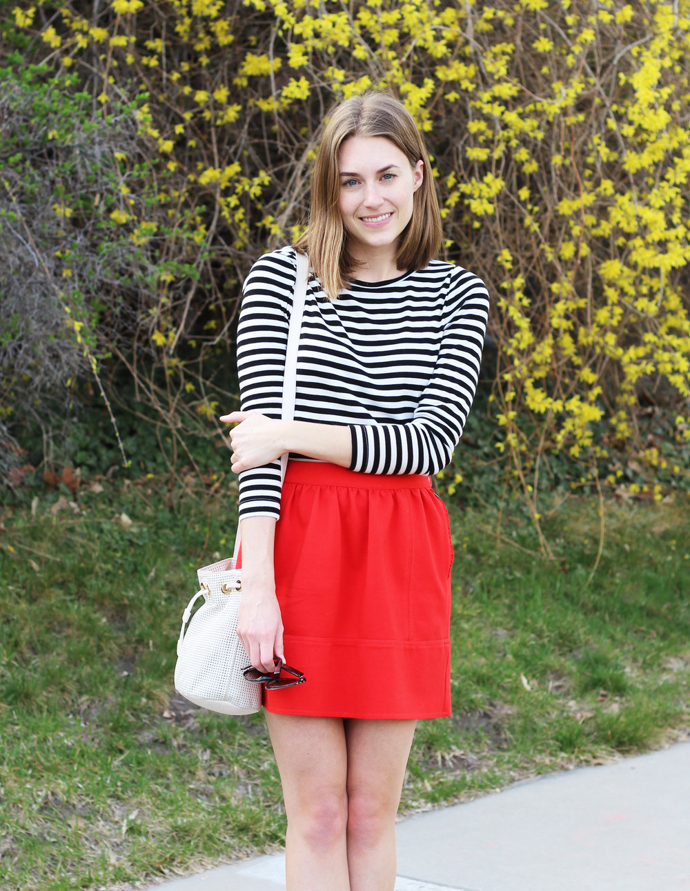 Spring outfit: black and white striped tee, red skirt, white bucket bag — Cotton Cashmere Cat Hair