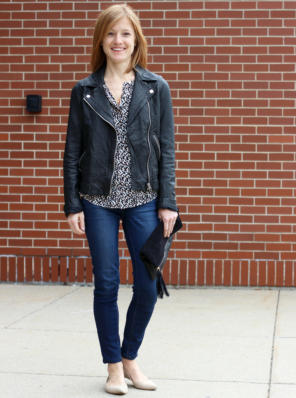 Anne of In Residence: Leather jacket, leopard-print blouse, skinny jeans, tan flats, black clutch