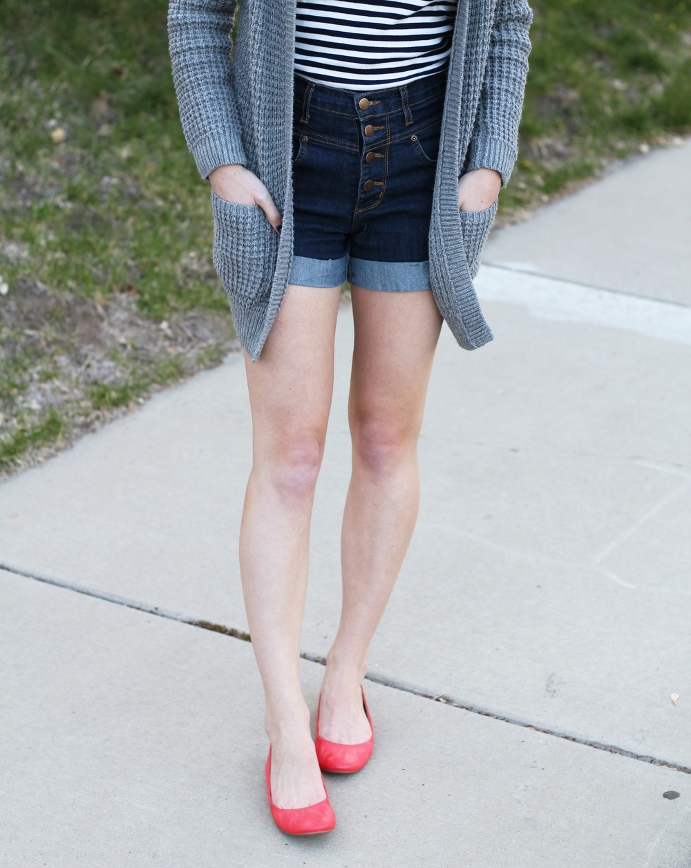 Chunky knit cardigan + navy striped tee + high-rise shorts + bright red flats — Cotton Cashmere Cat Hair