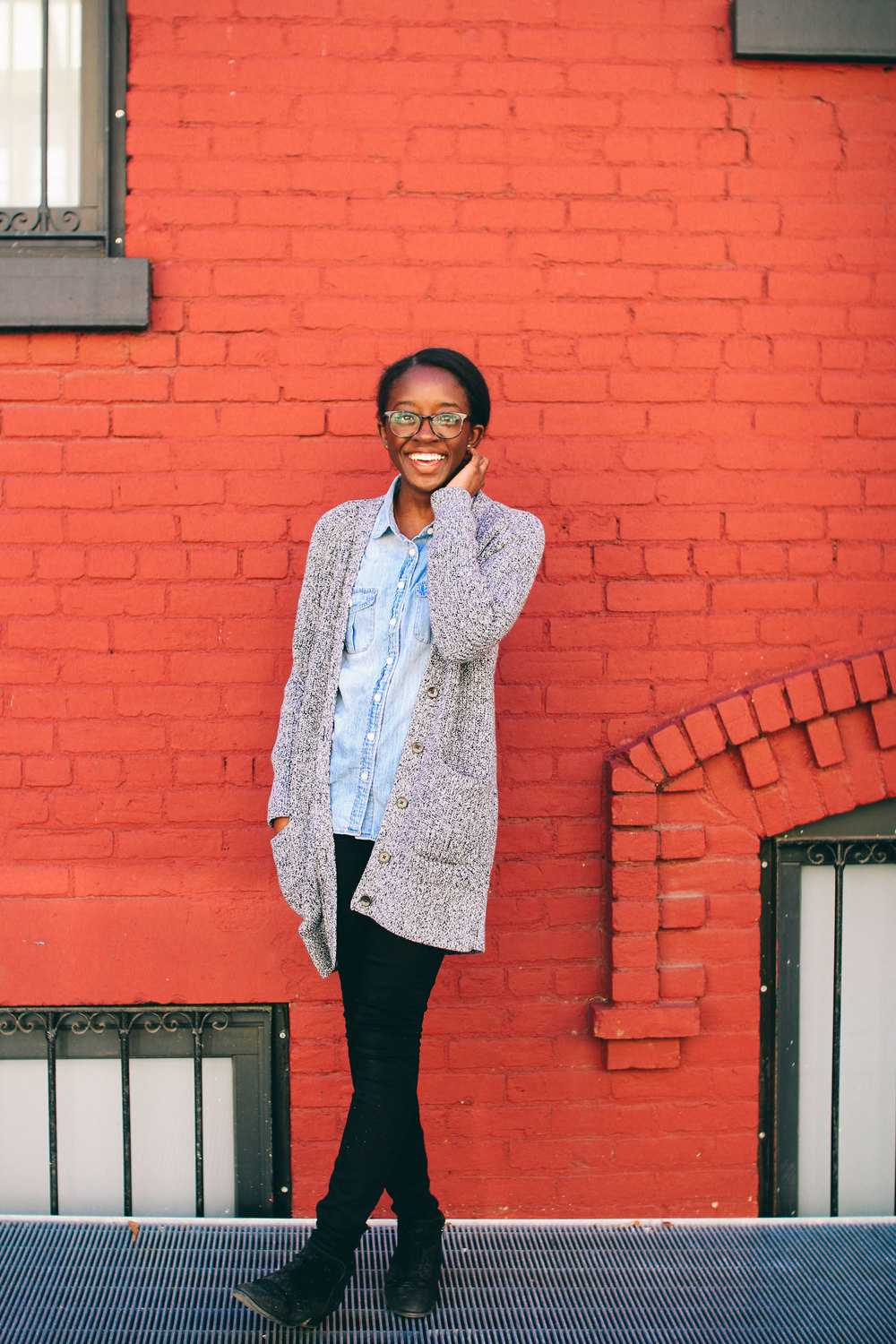 Toyosi of Unmapped Territory: Grey cardigan, chambray shirt, black denim, black boots