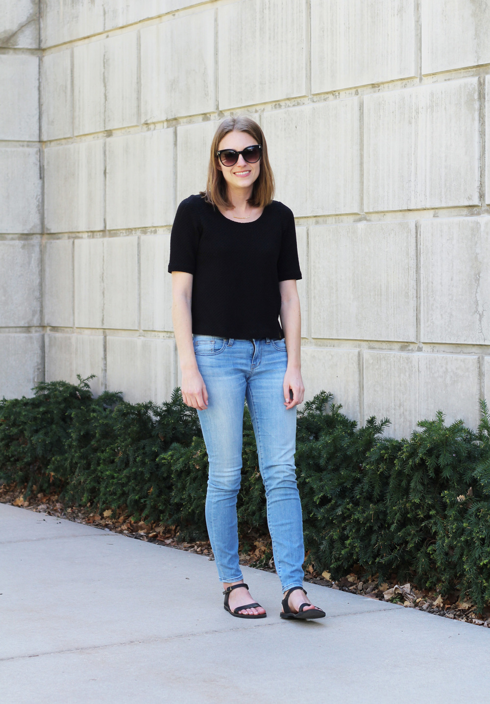 Black Anthropologie top, light wash Madewell skinny jeans, black sandals, gold Gorjana bar necklace — Cotton Cashmere Cat Hair