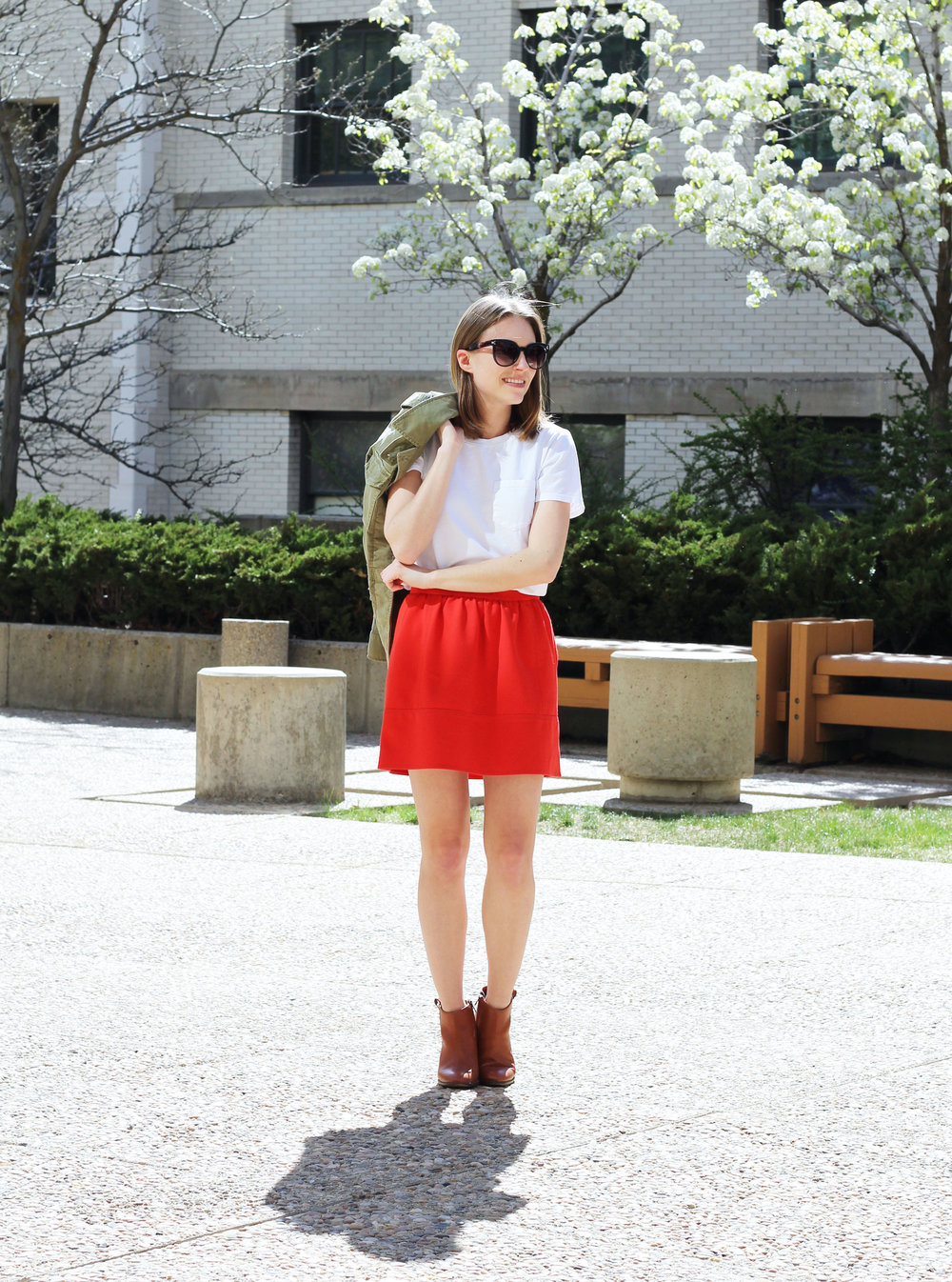 White Everlane box tee, red mini skirt, Madewell 'Billie' boots, olive green utility jacket — Cotton Cashmere Cat Hair