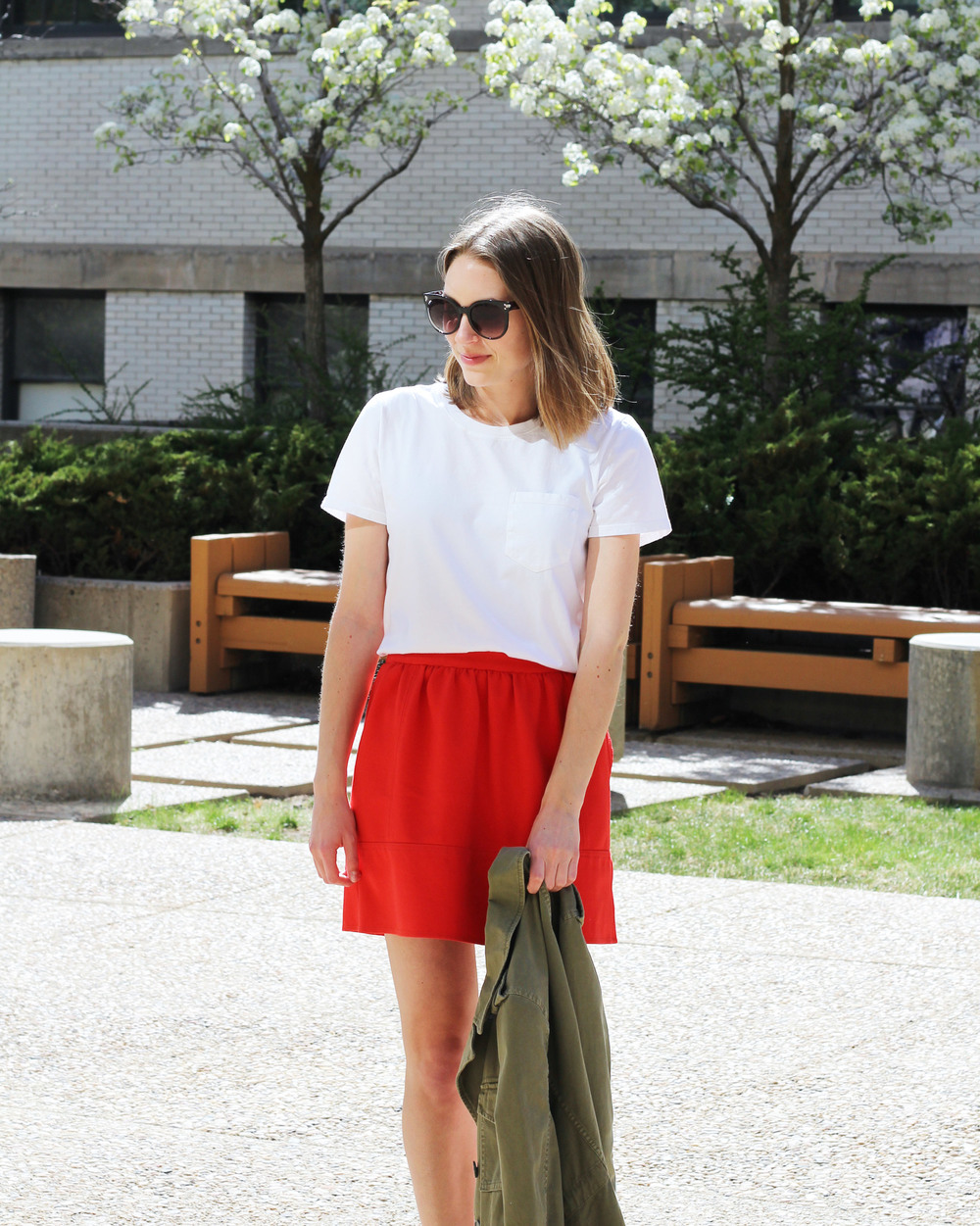 White tee + red mini skirt + army green utility jacket — Cotton Cashmere Cat Hair