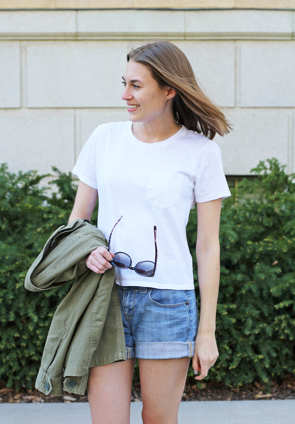 Everyday casual outfit: Everlane white box tee + denim shorts + utility jacket — Cotton Cashmere Cat Hair