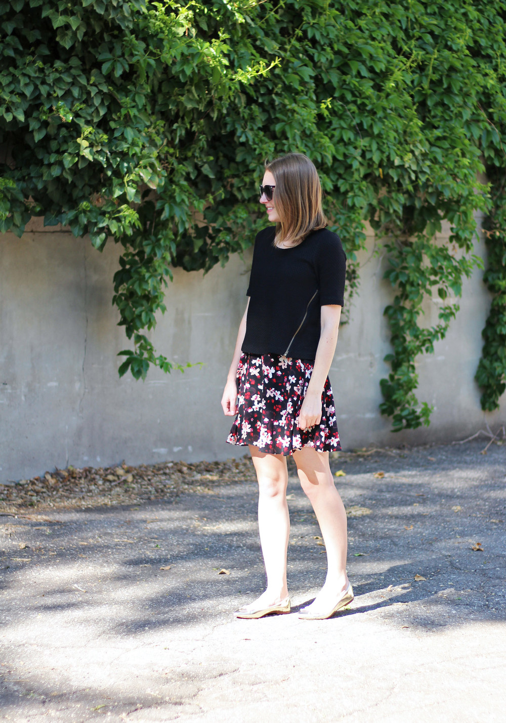Black Anthropologie top, dark floral skirt, metallic gold ballet flats — Cotton Cashmere Cat Hair