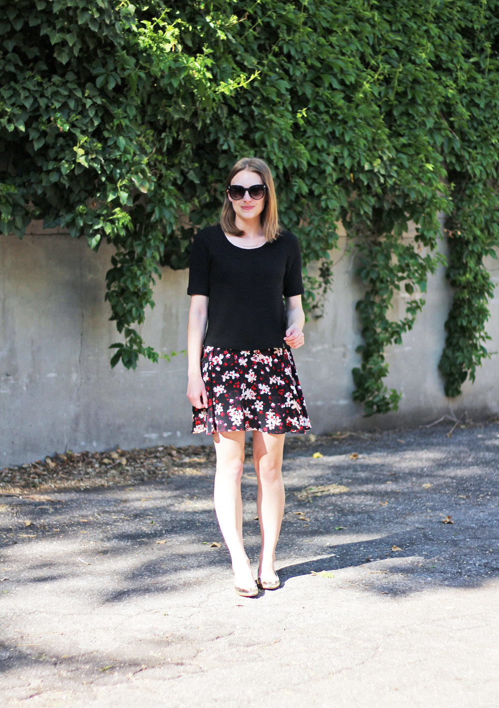 Black Anthropologie top + dark floral skirt + metallic gold flats — Cotton Cashmere Cat Hair