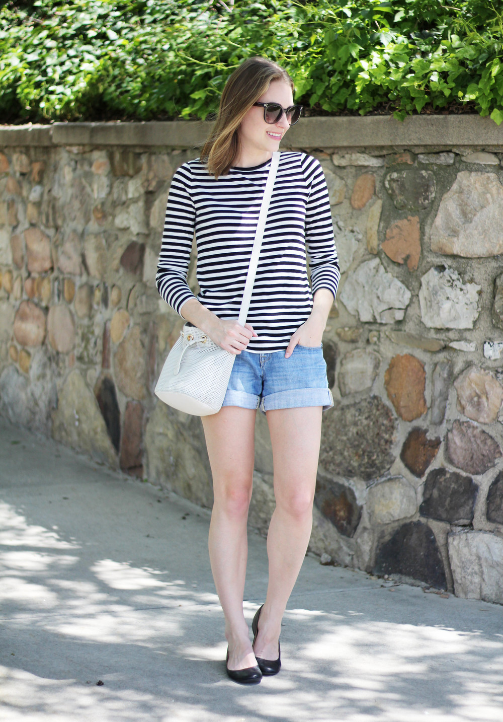 Striped tee, denim shorts, black ballet flats, white leather bucket bag — Cotton Cashmere Cat Hair