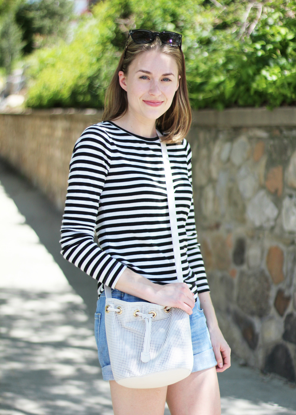 Black and white striped tee + denim shorts + white bucket bag — Cotton Cashmere Cat Hair