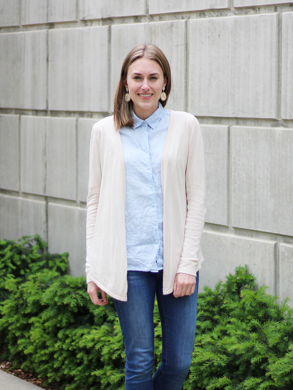 Light blue linen shirt outfit with beige cardigan and statement earrings — Cotton Cashmere Cat Hair