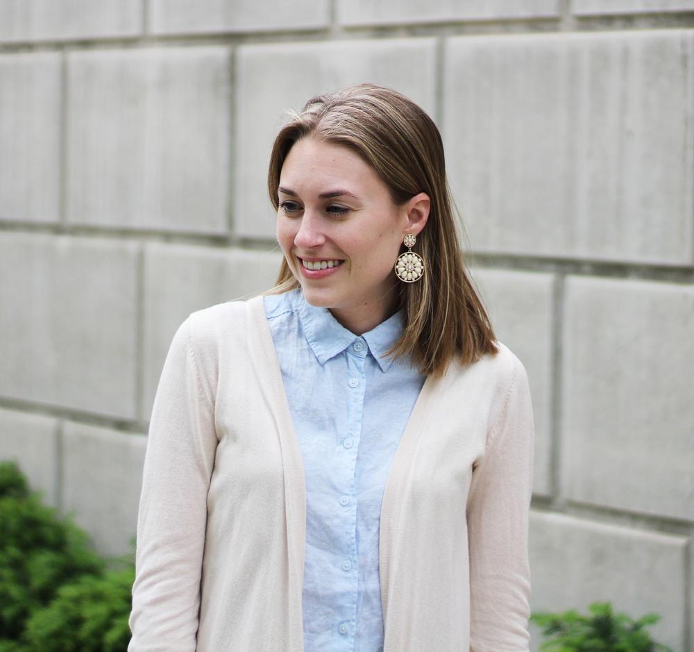 Statement earrings + beige cardigan + light blue linen shirt — Cotton Cashmere Cat Hair