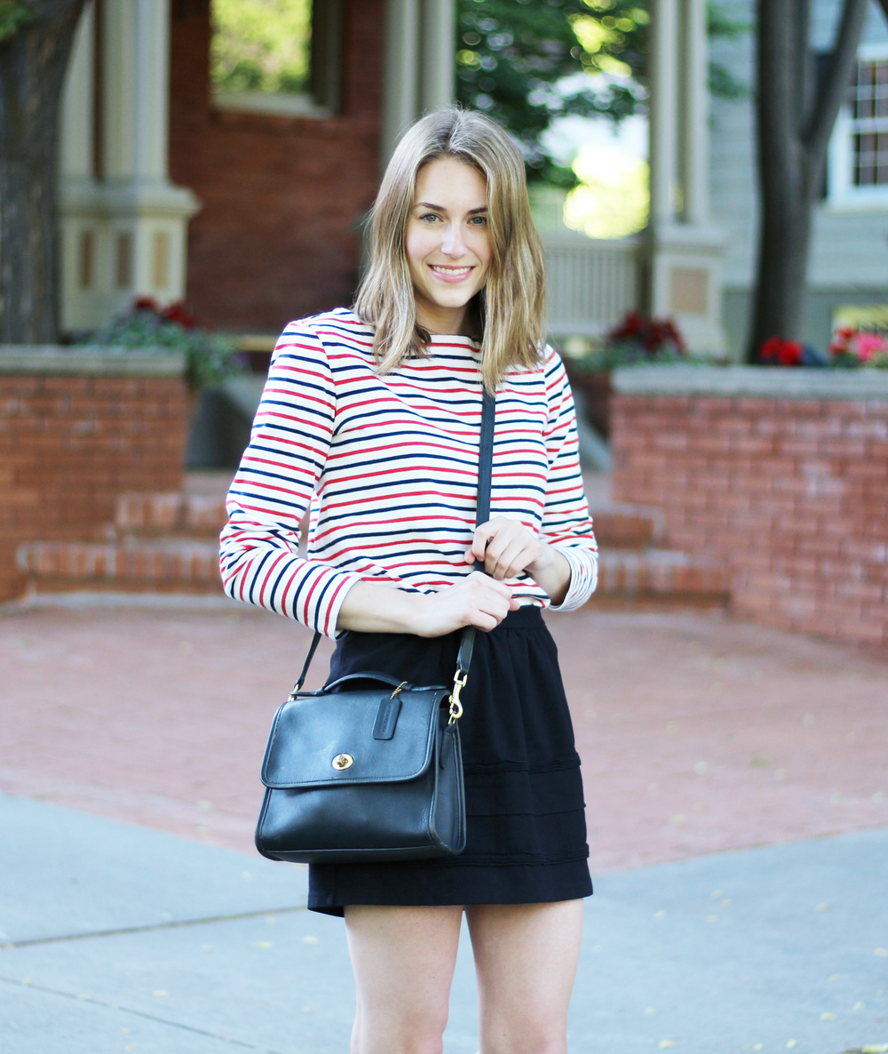 Navy and red striped tee outfit with navy Coach 'Court' bag and black skirt — Cotton Cashmere Cat Hair
