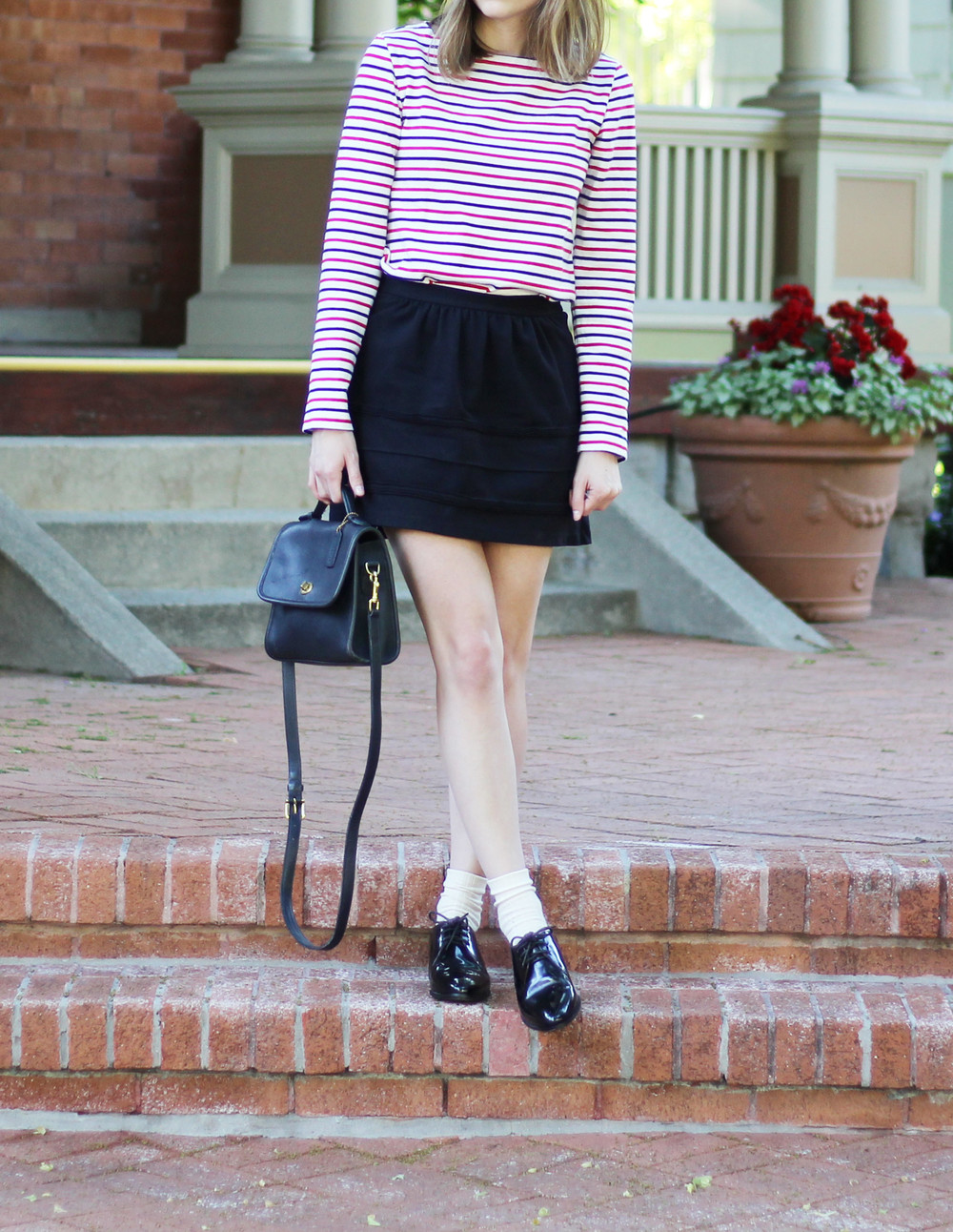 Navy and red striped tee, black mini skirt, navy Coach 'Court bag, black oxfords — Cotton Cashmere Cat Hair