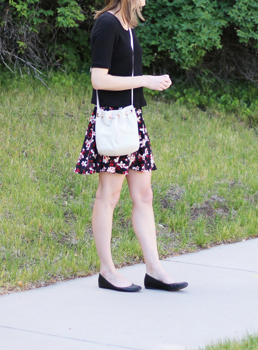 Black cropped top, dark floral skirt, black ballet flats, white leather bucket bag — Cotton Cashmere Cat Hair