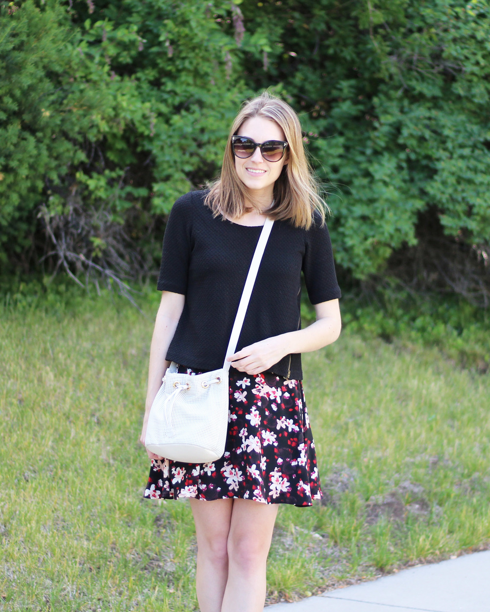 Black cropped top and dark floral skirt outfit with white bucket bag — Cotton Cashmere Cat Hair