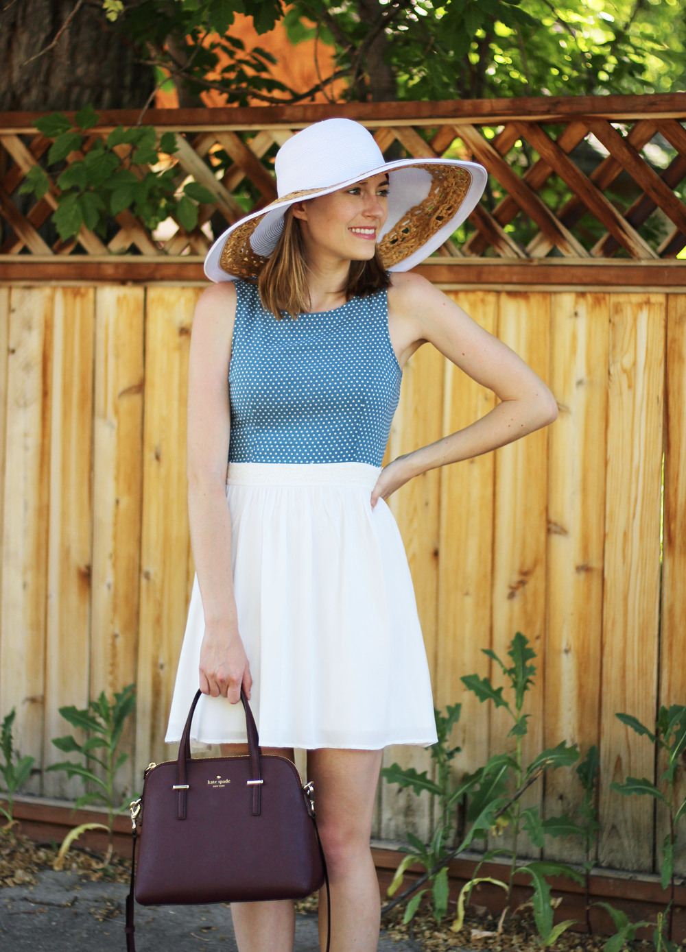 Polka dot sundress, white sun hat, burgundy Kate Spade bag — Cotton Cashmere Cat Hair