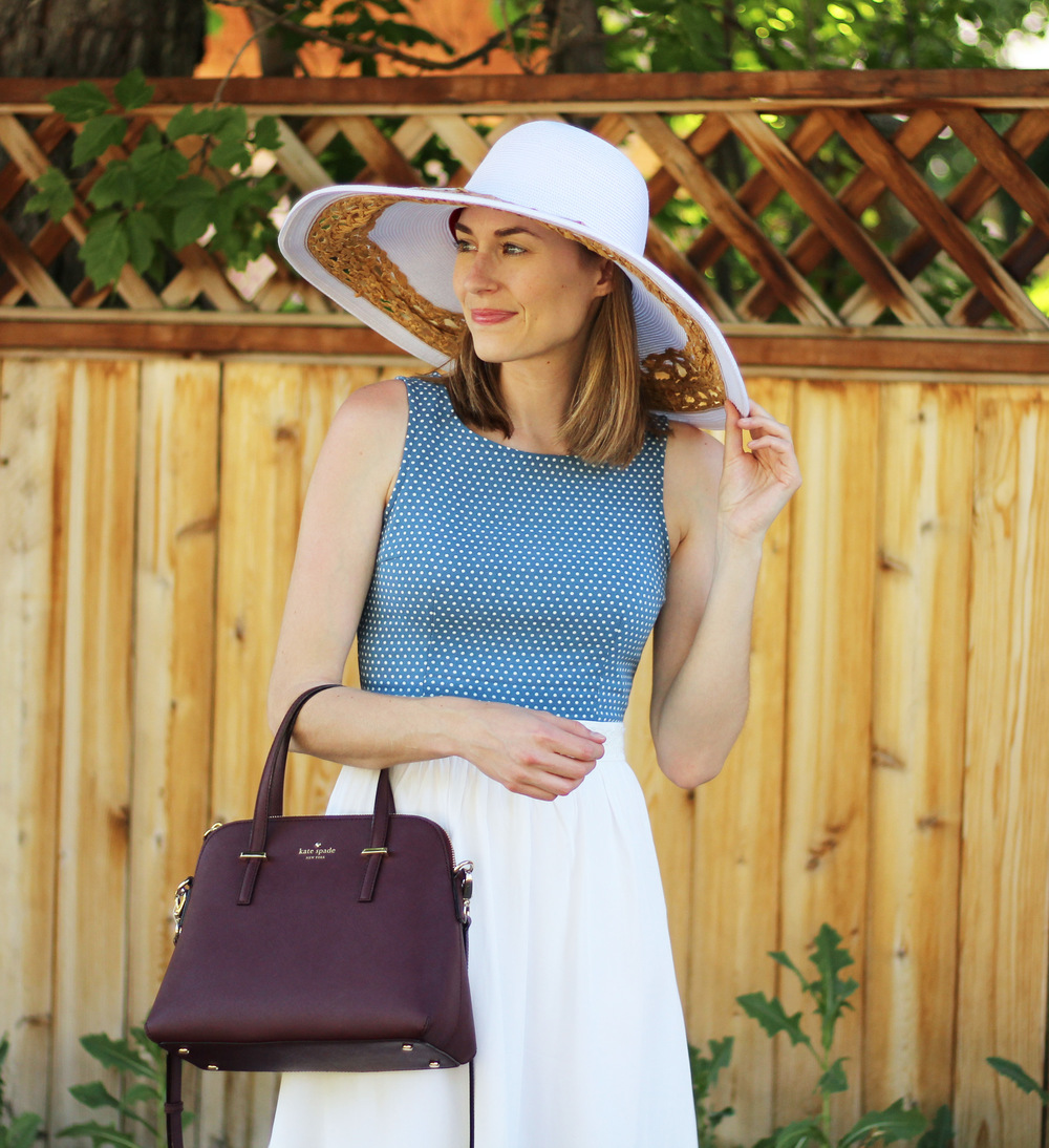 Blue and white dress, burgundy Kate spade bag, white sun hat — Cotton Cashmere Cat Hair