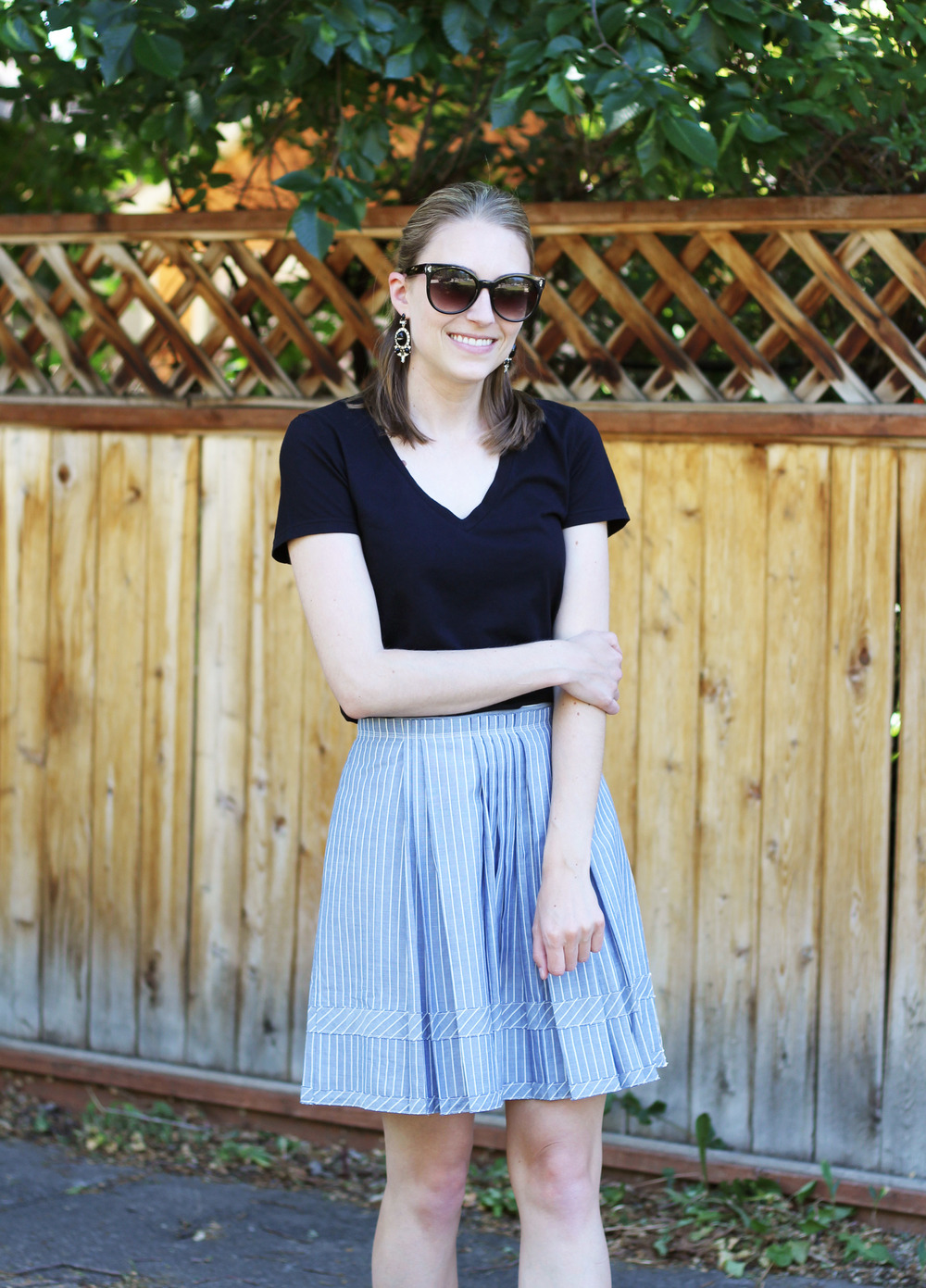 Black tee, blue Madewell shirtstripe skirt, statement earrings — Cotton Cashmere Cat Hair