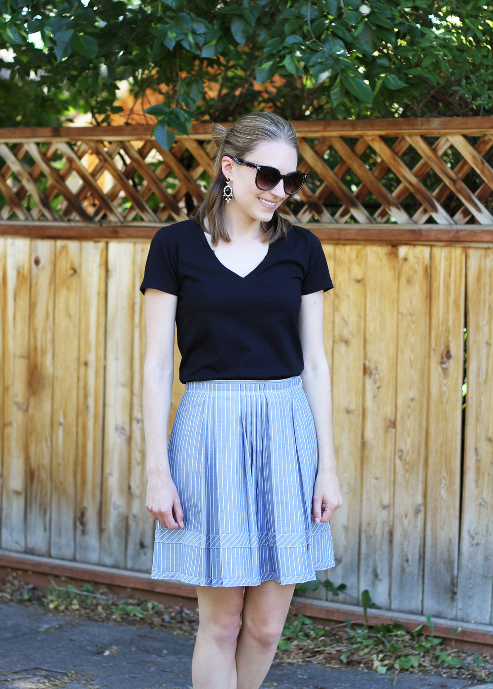 Black tee + blue striped skirt + statement earrings — Cotton Cashmere Cat Hair