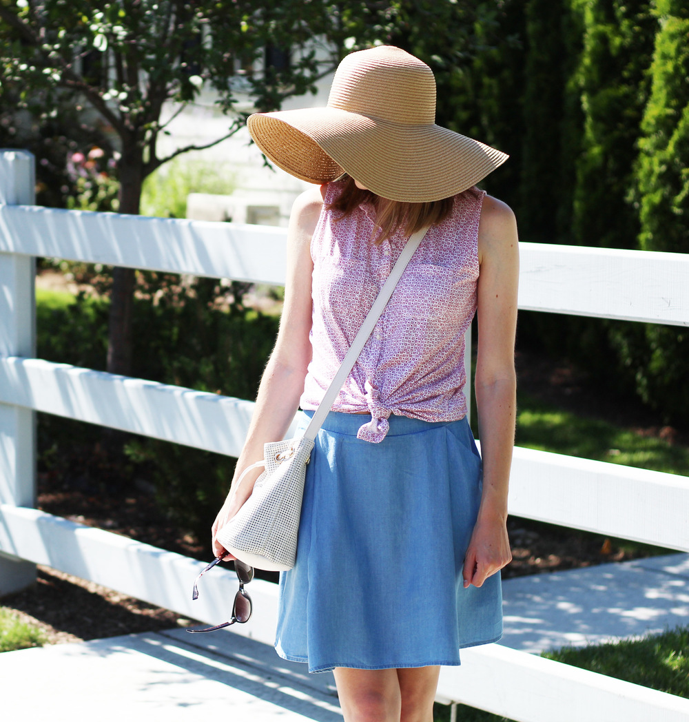 Fourth of July outfit: Red floral shirt + chambray skirt + white bucket bag + floppy sun hat — Cotton Cashmere Cat Hair