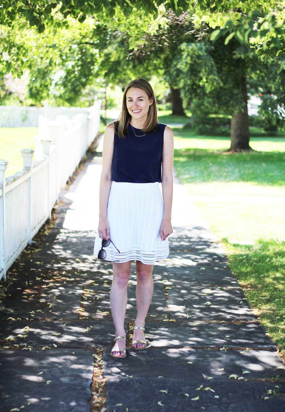 Grana navy silk shell, J.Crew white eyelet skirt, Sandelles gold sandals, Gorjana bar necklace — Cotton Cashmere Cat Hair