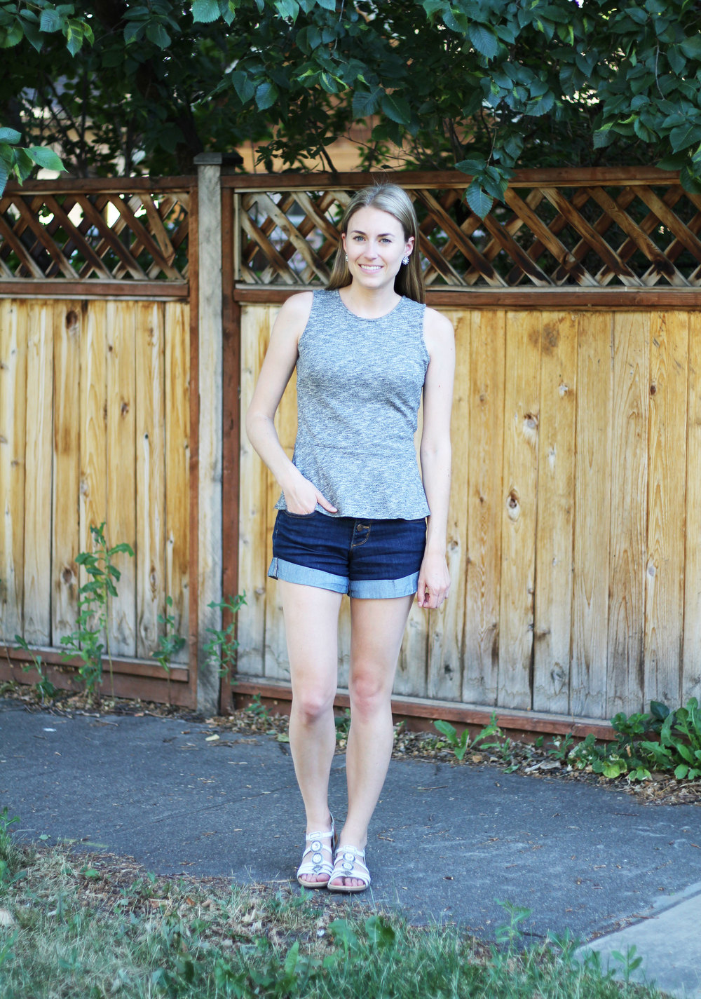 Grey peplum top with high rise shorts and white sandals — Cotton Cashmere Cat Hair